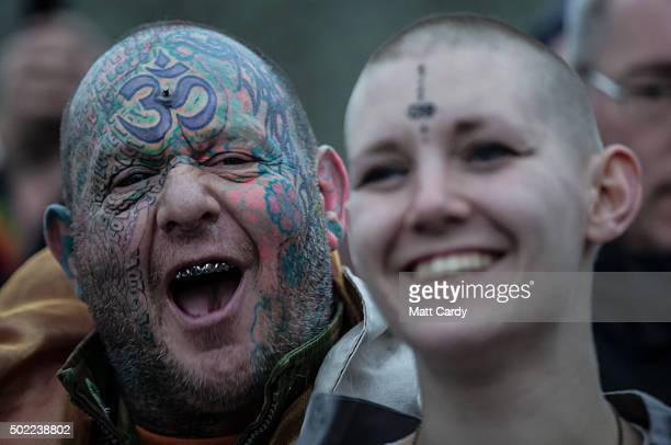 A reveller known as Mad Al cheers as druids pagans and revellers gather in the centre of Stonehenge hoping to see the sun rise as they take part in a...