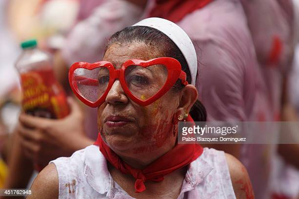 A reveller looks on during the opening and the firing of the 'Chupinazo' rocket which starts the 2014 Festival of the San Fermin Running of the Bulls...