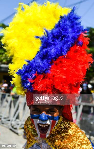 Reveller named Congo pose before the Carnival parade in Barranquilla Colombia on February 11 2018 / AFP PHOTO / Luis ACOSTA