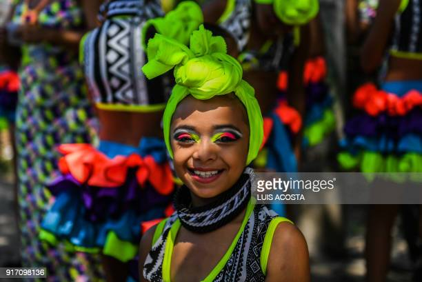 Reveller named Mapale pose before the Carnival parade in Barranquilla Colombia on February 11 2018 / AFP PHOTO / Luis ACOSTA