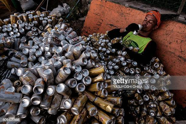 A reveller of Bloco da Latinha a street carnival group drinks beer after a parade on the last day of carnival in Madre de Deus Bahia State Brazil on...