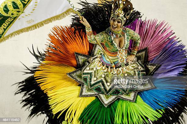 A reveller of Imperatriz Samba School 6th in the 2015 Rio's Carnival performs during the Champions' Parade at the Sambadrome in Rio Brazil on...