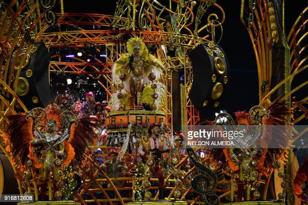 A reveller of the Dragoes da Real samba school performs during the second night of carnival in Sao Paulo Brazil at the city's Sambadrome early on...