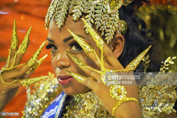A reveller of the Imperio Serrano gestures before performing on the first night of Rio's Carnival at the Sambadrome in Rio de Janeiro Brazil on...