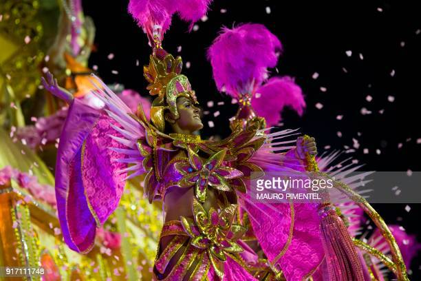 A reveller of the Imperio Serrano performs on the first night of Rio's Carnival at the Sambadrome in Rio de Janeiro Brazil on February 11 2018 / AFP...
