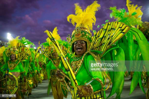 TOPSHOT A reveller of the Mocidade samba school performs as the sun rises after during the first night of Rio's Carnival at the Sambadrome in Rio...