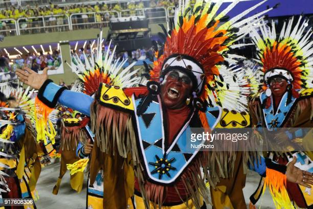 A reveller of the PORTELA samba school performs during the first night of Rio's Carnival at the Sambadrome in Rio Brazil on February 12 2018