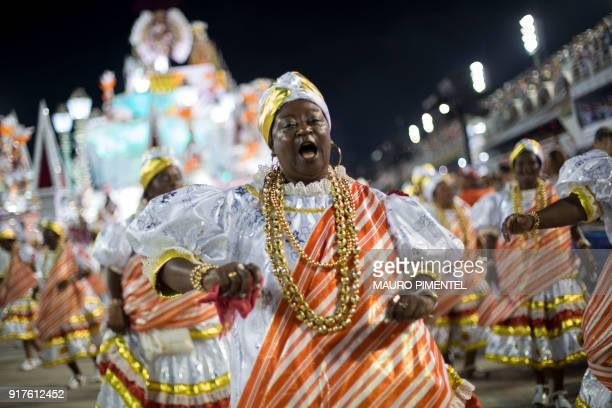 A reveller of the Salgueiro samba school performs during the second night of Rio's Carnival at the Sambadrome in Rio de Janeiro Brazil on February 13...