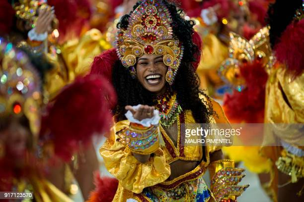 A reveller of the Sao Clemente performs on the first night of Rio's Carnival at the Sambadrome in Rio de Janeiro Brazil on February 11 2018 / AFP...