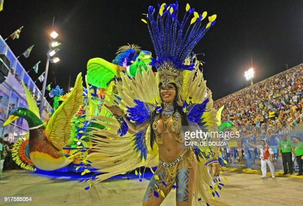 A reveller of the Uniao da Ilha samba school performs during the second night of Rio's Carnival at the Sambadrome in Rio de Janeiro Brazil on...