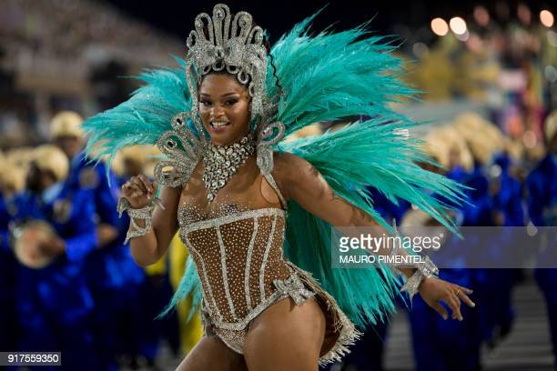TOPSHOT A reveller of the Unidos da Tijuca samba school performs during the second night of Rio's Carnival at the Sambadrome in Rio de Janeiro Brazil...
