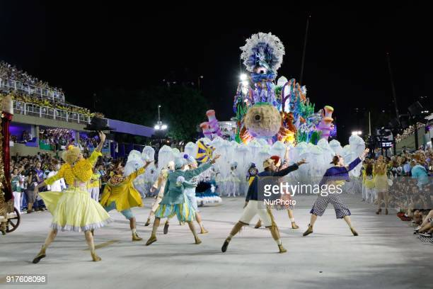 A reveller of the Unidos da Tijuca samba school performs during the first night of Rio's Carnival at the Sambadrome in Rio Brazil on February 12 2018