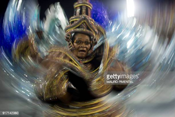 TOPSHOT A reveller of the Vila Isabel samba school performs on the first night of Rio's Carnival at the Sambadrome in Rio de Janeiro Brazil on...