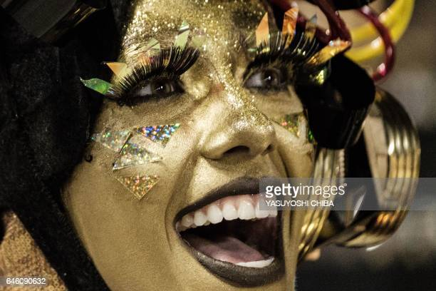 A reveller of Unidos da Tijuca samba school waits for the start of their parade on the second night of Rio's Carnival at the Sambadrome in Rio de...