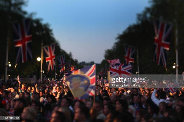 Reveller on the The Mall enjoy the festivities as thousands gather for The Diamond Jubilee Concert on June 4 2012 in London England For only the...