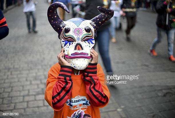 A reveller participates in the Ninth Monumental 'Alebrijes' Parade and contest on October 17 2015 in Mexico City Some 221 'Alebrijes' coloured...