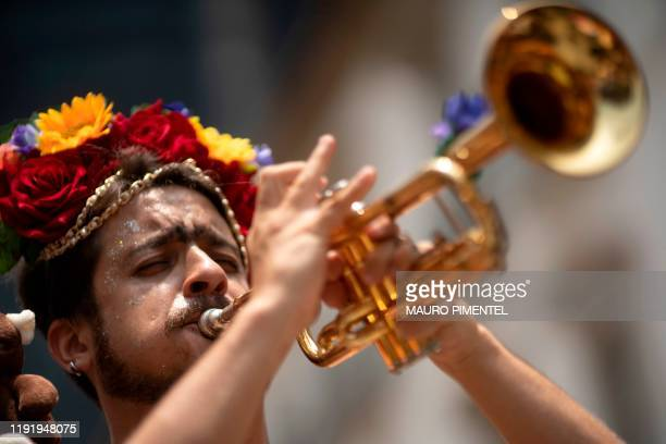 A reveller plays the trumpet during the street carnival parade of the bloco Terreirada Cearense at the XV Square in Rio de Janeiro Brazil on January...
