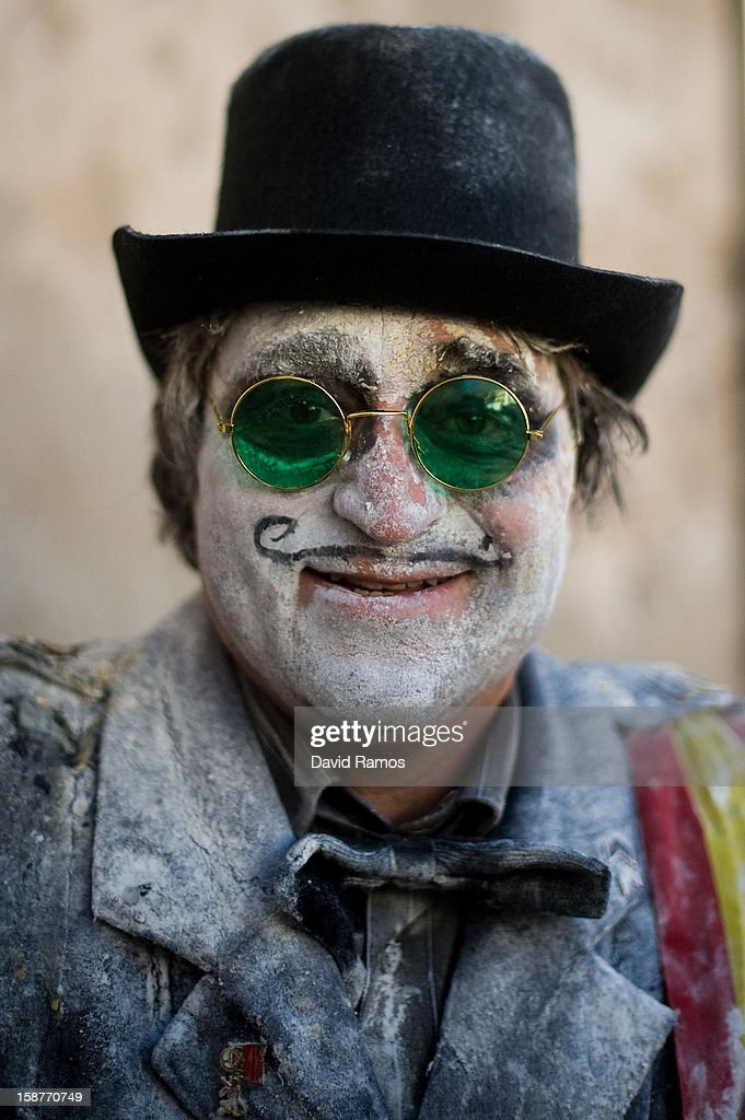 A Reveller poses after taking part in the battle of 'Enfarinats', a flour fight in celebration of the Els Enfarinats festival on December 28, 2012 in Ibi, Spain. Citizens of Ibi annually celebrate the festival with a battle using flour, eggs and firecrackers. The battle takes place between two groups, a group of married men called 'Els Enfarinats' which take the control of the village for one day pronouncing a whole of ridiculous laws and fining the citizens that infringe them and a group called 'La Oposicio' which try to restore order. At the end of the day the money collected from the fines is donated to charitable causes in the village. The festival has been celebrated since 1981 after the town of Ibi recovered the tradition but the origins remain unknown.