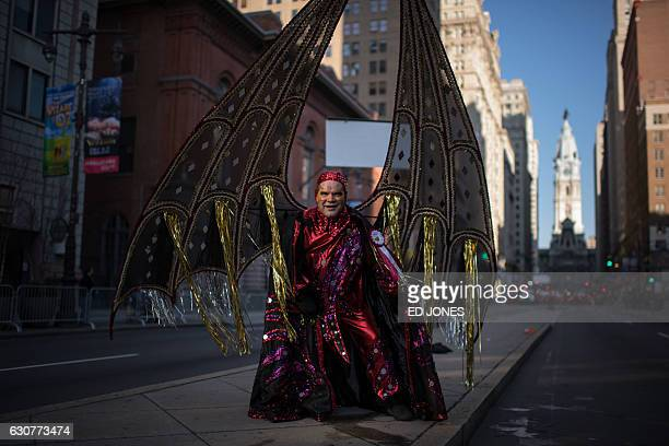 A reveller poses for a photo in fancy dress during the annual Mummers Parade in Philadelphia on January 1 2017 The Mummers Parade is a 120yearold...