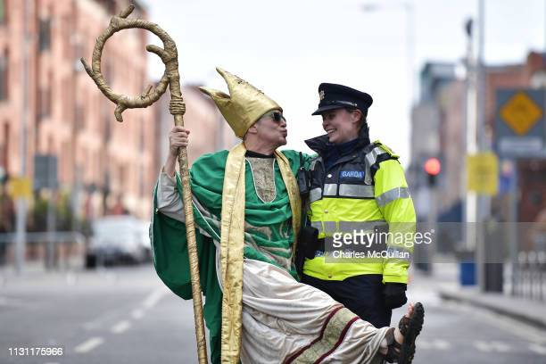 A reveller poses with a policewoman on March 17 2019 in Dublin Ireland Saint Patrick the patron saint of Ireland is celebrated around the world on St...