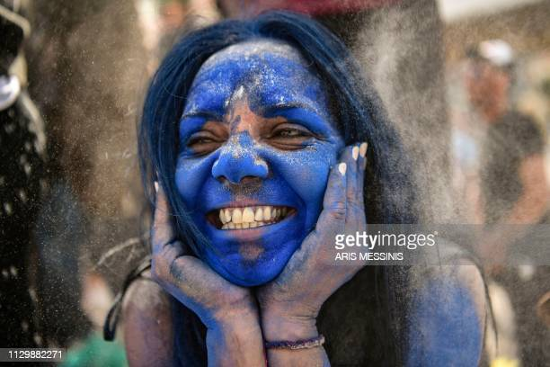 TOPSHOT A reveller reacts amid a 'flour war' during the 'Ash Monday' celebrations a traditional festivity marking the end of the carnival season and...
