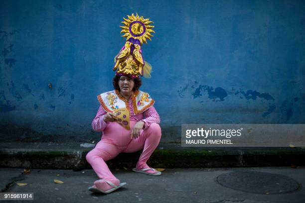"Reveller rests during the street carnival parade of the ""Loucura Suburbana"" bloco at the Engenho de Dentro neighborhood in Rio de Janeiro, Brazil, on..."