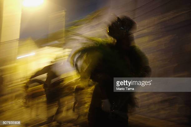 A reveller runs during preCarnival celebrations on February 1 2016 in Olinda Pernambuco state Brazil In the last four months authorities have...