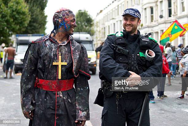 A reveller shares a joke with a police officer as Notting Hill Carnival begins on August 28 2016 in London England The Notting Hill Carnival has...