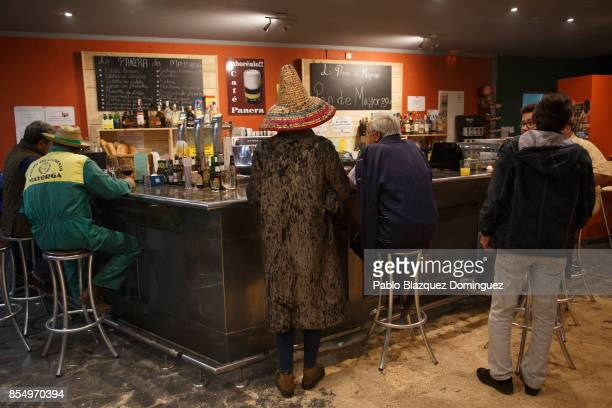 A reveller stands in a bar during El Vitor Civic procession on September 27 2017 in Mayorga Valladolid province Spain Every 27 of September Mayorga...