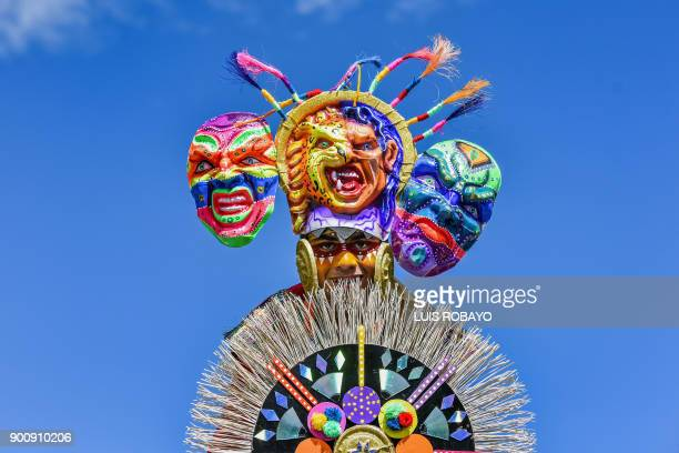 TOPSHOT A reveller takes part in the Canto a la Tierra parade on January 3 during the Carnival of Blacks and Whites in Pasto Colombia the largest...