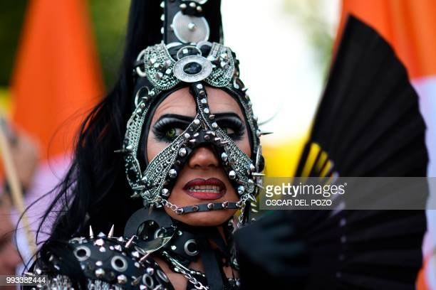 A reveller takes part in the Gay Pride 2018 parade in Madrid on July 7 one of the world's biggest