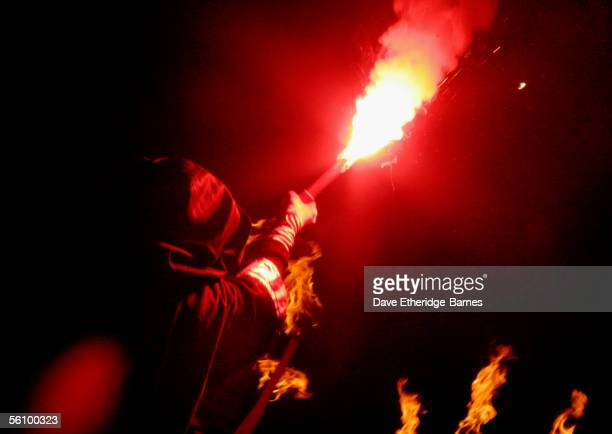 Reveller walks with a flare during the Bonfire Night celebrations on November 5, 2005 in Lewes, Sussex in England. Bonfire Night is related to the...