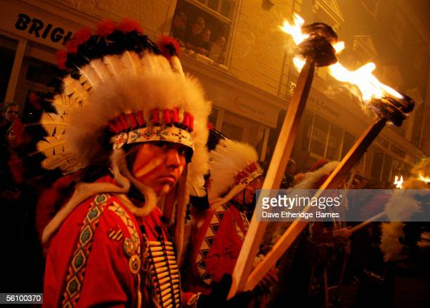 A reveller walks with a torch during the Bonfire Night celebrations on November 5 2005 in Lewes Sussex in England Bonfire Night is related to the...
