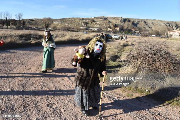 A reveller wearing a mask and a costume is seen during a traditional carnival celebration in the small village of Luzon Spain Preserved records from...