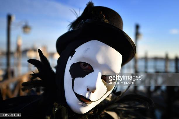 A reveller wearing a mask and a period costume takes part in the Venice Carnival on February 24 2019 in Venice