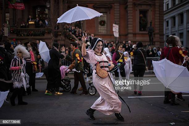 A reveller wearing fancy dress participates in the annual Mummers Parade in Philadelphia on January 1 2017 The Mummers Parade is a 120yearold folk...