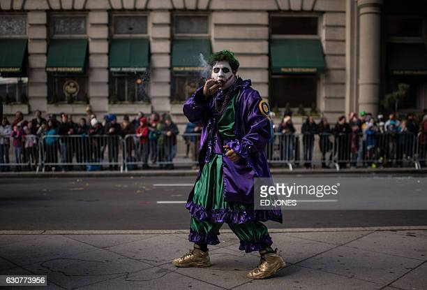 A reveller wearing fancy dress smokes a cigar during the annual Mummers Parade in Philadelphia on January 1 2017 The Mummers Parade is a 120yearold...