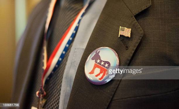 A reveller wears a Democrat badge as guests wait for the results of the US presidential election at an election night party at the US Embassy in...
