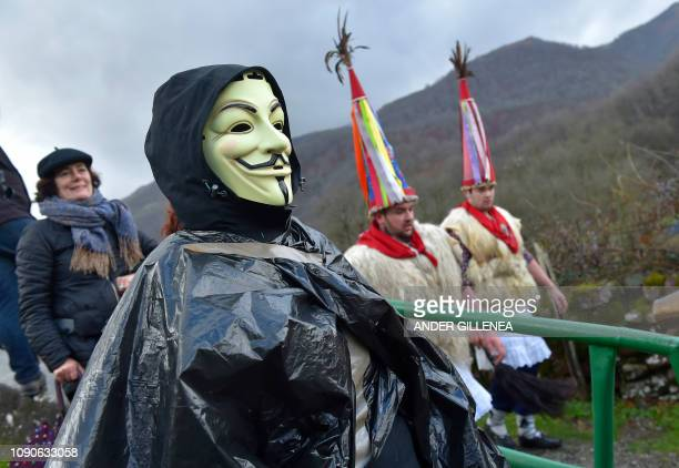 A reveller with a Guy Fawkes mask takes part in the ancient carnival of Ituren in the northern Spanish Navarra province on January 28 2019 The yearly...