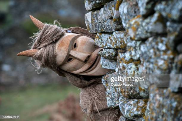 Reveller with wooden mask and carnival garb during the traditional Celtic carnival 'Caretos' in Lazarim on February 27 2017 in Lamego Portugal During...