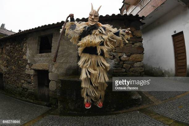 Reveller with wooden mask and carnival garb during the traditional Celtic parade carnival 'Caretos' in Lazarim on February 28 2017 in Lamego Portugal...