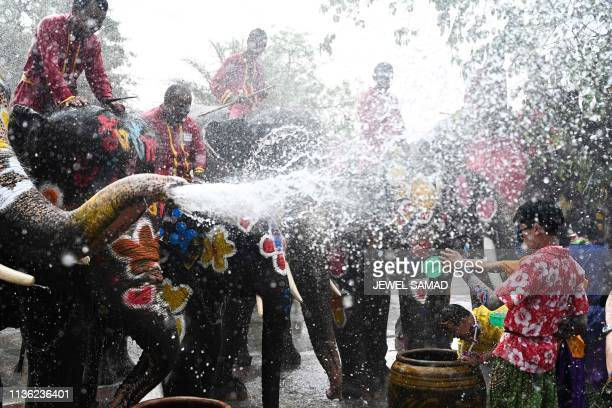 Revellers and elephants splash water at each other during a ceremony to celebrate the Buddhist New Year, locally known as Songkran, in Ayutthaya on...