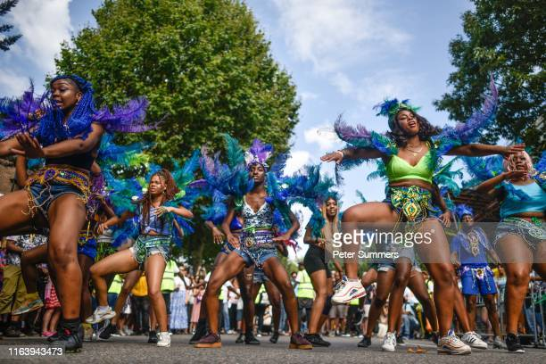 Revellers and paraders attend the Notting Hill carnival on August 25, 2019 in London, England. One million people are expected on the streets in...