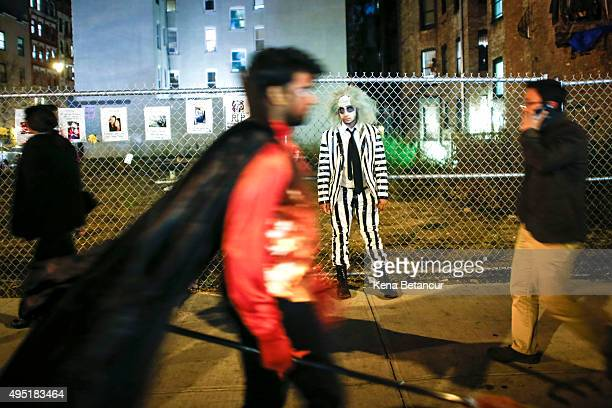 Revellers are seen in the East Village after the 42nd Annual Halloween Parade October 31 2015 in New York City