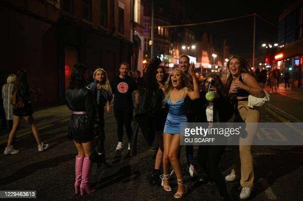 Revellers are seen in the street after pub closing time in Leeds, northern England on November 4 on the eve of a second novel coronavirus COVID-19...