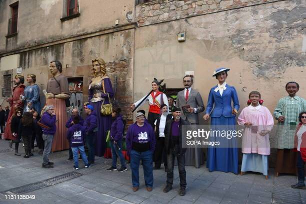 Revellers are seen standing around the Gigantes' during the celebration The Raval district in Barcelona Spain celebrates the Santa Madrona festival...
