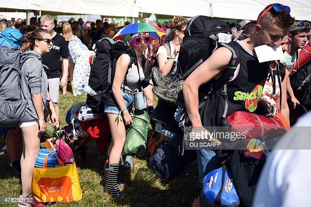 Revellers arrive to attend the Glastonbury Festival of Music and Performing Arts on Worthy Farm near the village of Pilton in Somerset South West...