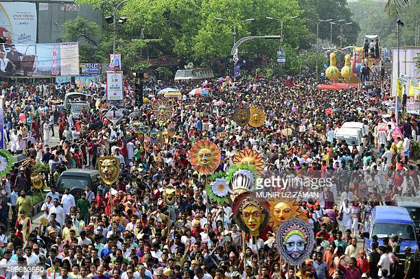 Revellers attend a rally in celebration of the Bengali New Year or Pohela Boishakh in Dhaka on April 14 2015 The Bengali calendar or Bangla calendar...