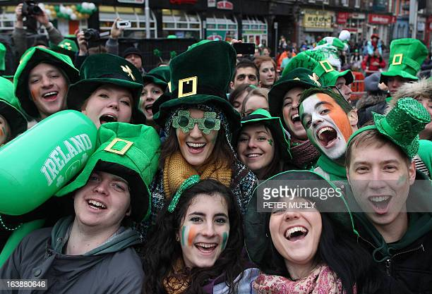 Revellers attend St Patrick's Day festivities in Dublin on March 17 2013 More than 100 parades are being held across Ireland to mark St Patrick's Day...