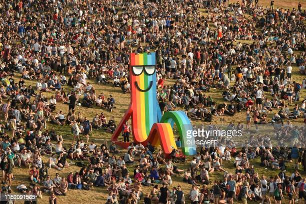 TOPSHOT Revellers attend the Glastonbury Festival of Music and Performing Arts on Worthy Farm near the village of Pilton in Somerset South West...